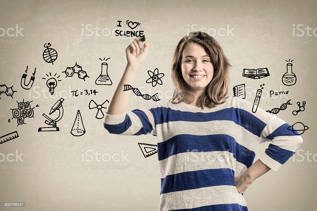 Smiling Teenage Girl, with Science Doodles stock photo