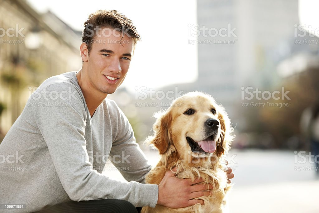 Smiling teenager and his dog. royalty-free stock photo