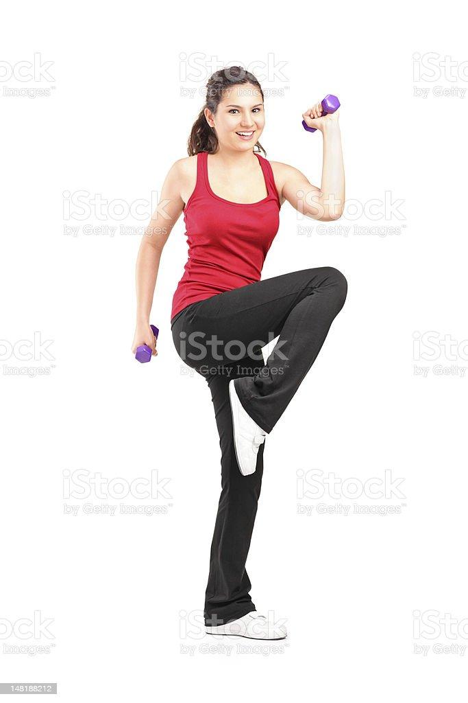 Smiling teenager lifting up dumbbells royalty-free stock photo