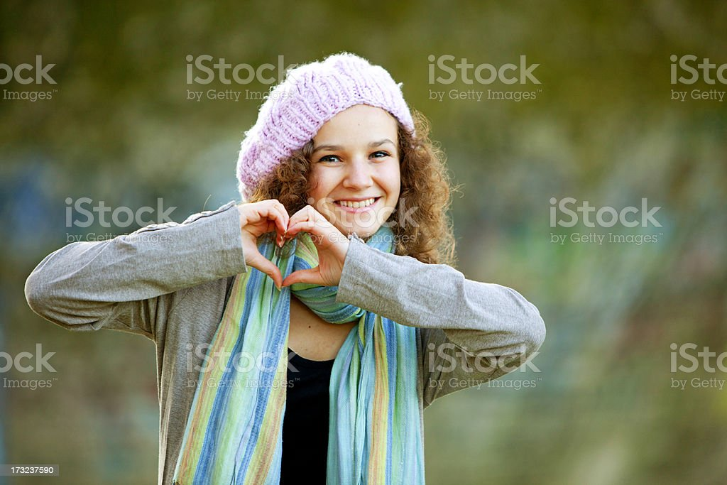 smiling teenager making heart shape royalty-free stock photo
