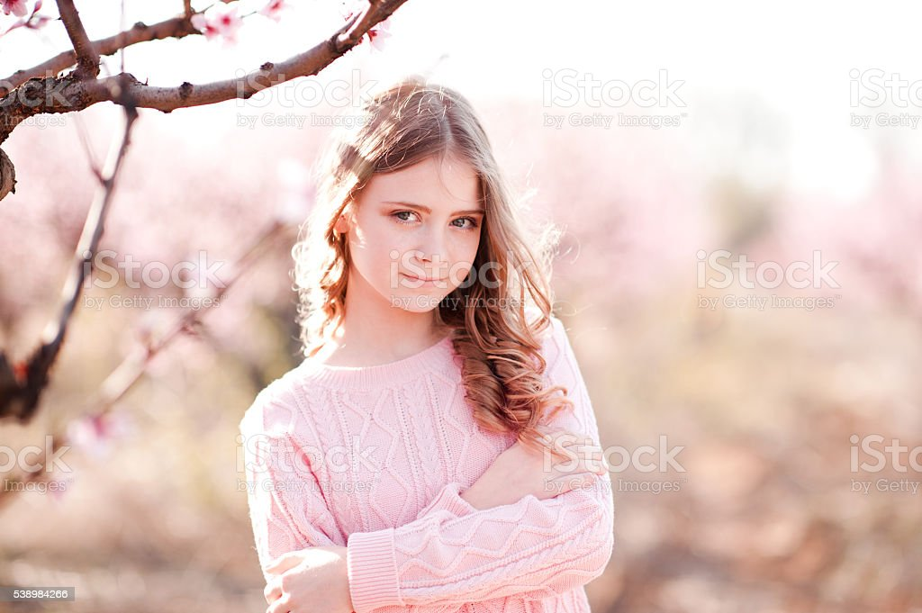 Smiling teenager posing outdoors stock photo