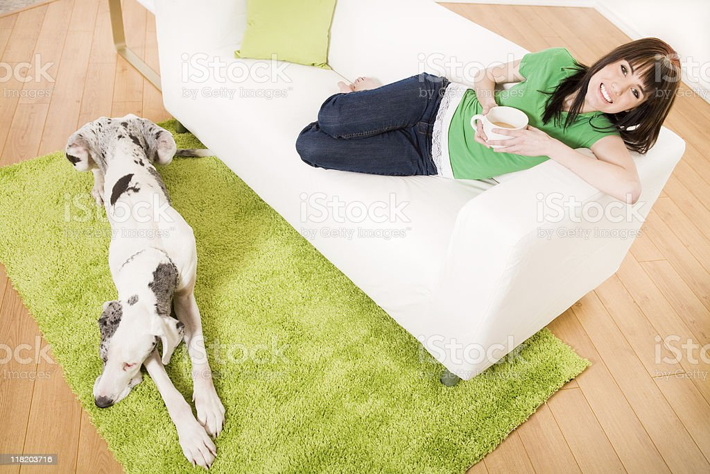 Smiling teenager relaxing on the couch royalty-free stock photo