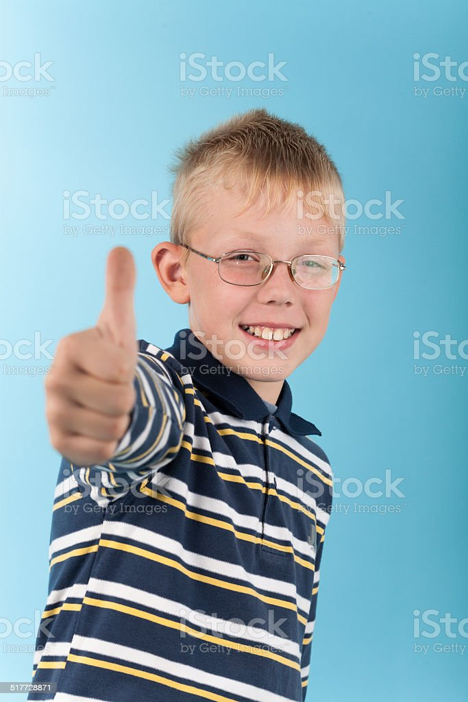 Smiling teenager show thumb up sign stock photo
