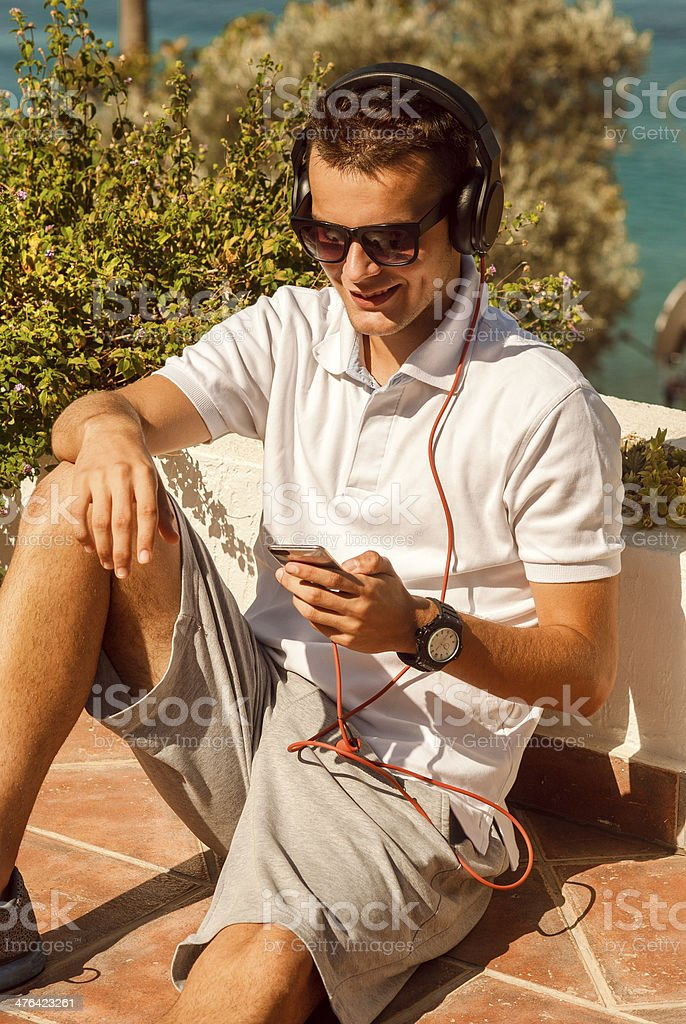 smiling teenager sitting on the balcony royalty-free stock photo