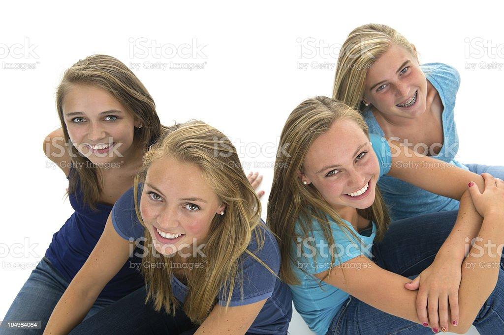 Smiling teens friends (studio shot) stock photo