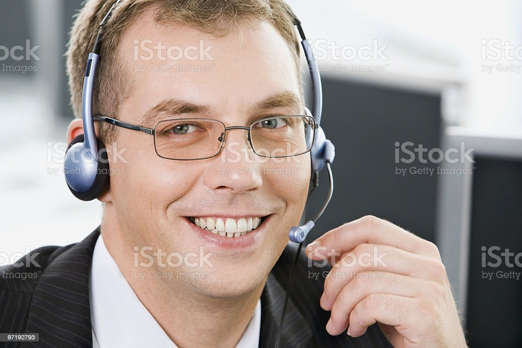 Smiling telephone operator royalty-free stock photo
