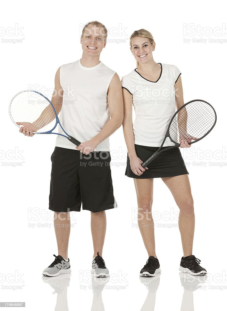 Smiling tennis players with rackets royalty-free stock photo