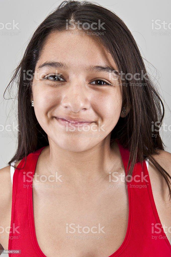 Smiling thirteen years old hispanic girl royalty-free stock photo