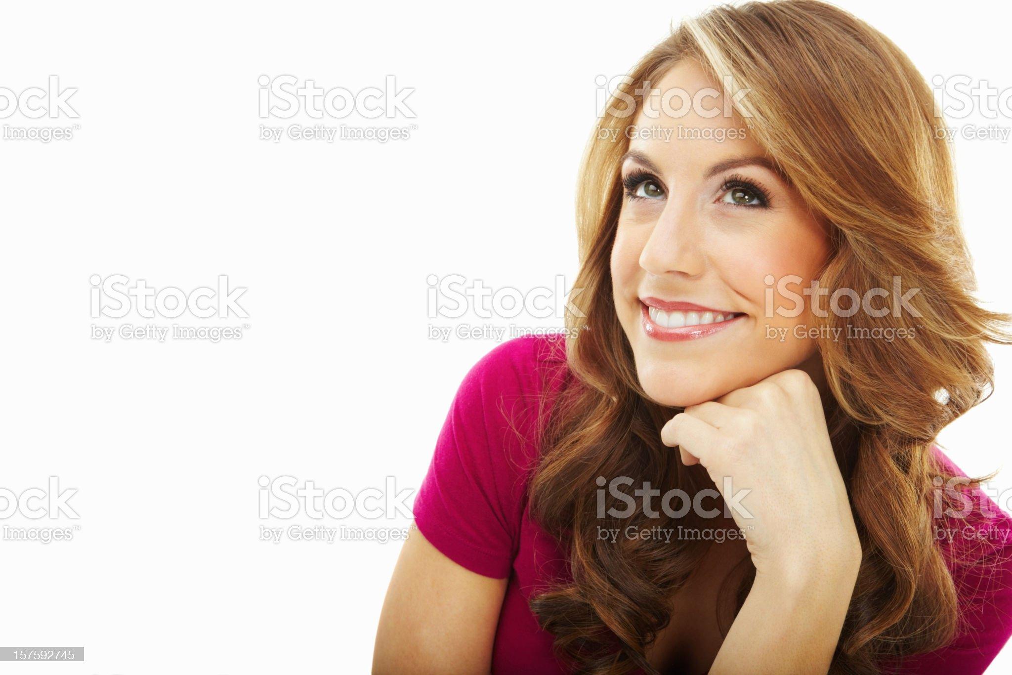 Smiling thoughtful female isolated against white royalty-free stock photo