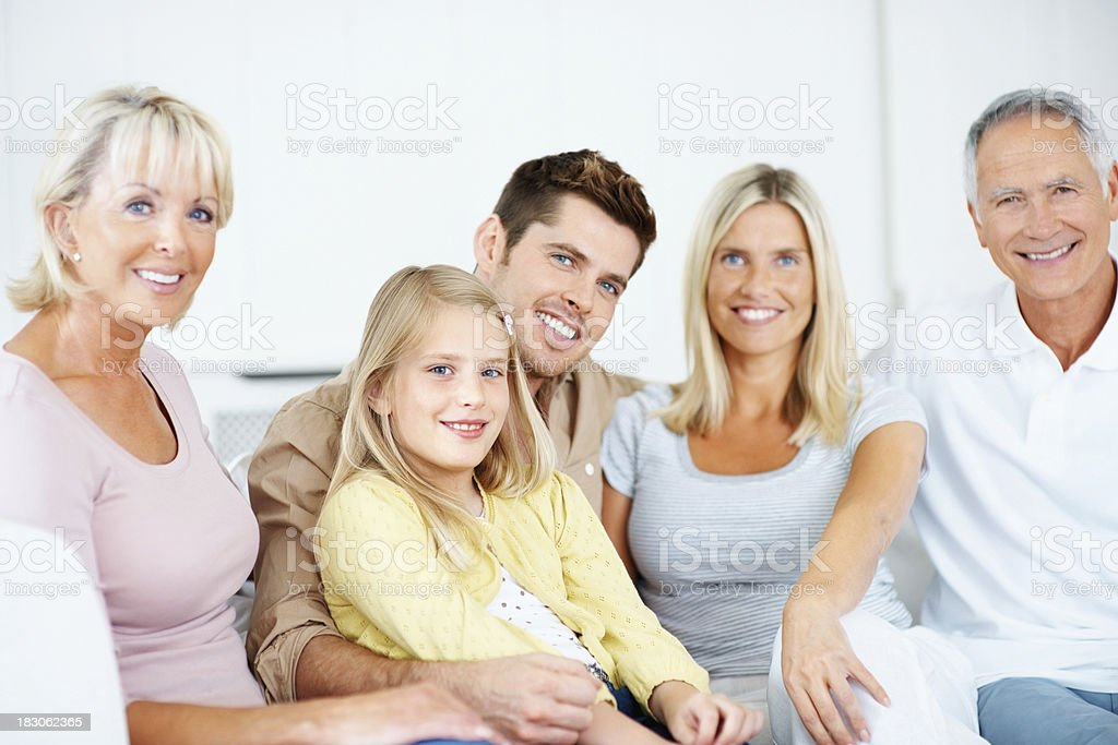 Smiling three generational family sitting together royalty-free stock photo