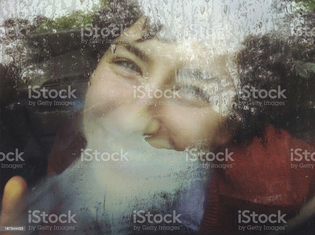 Smiling through Car Window stock photo