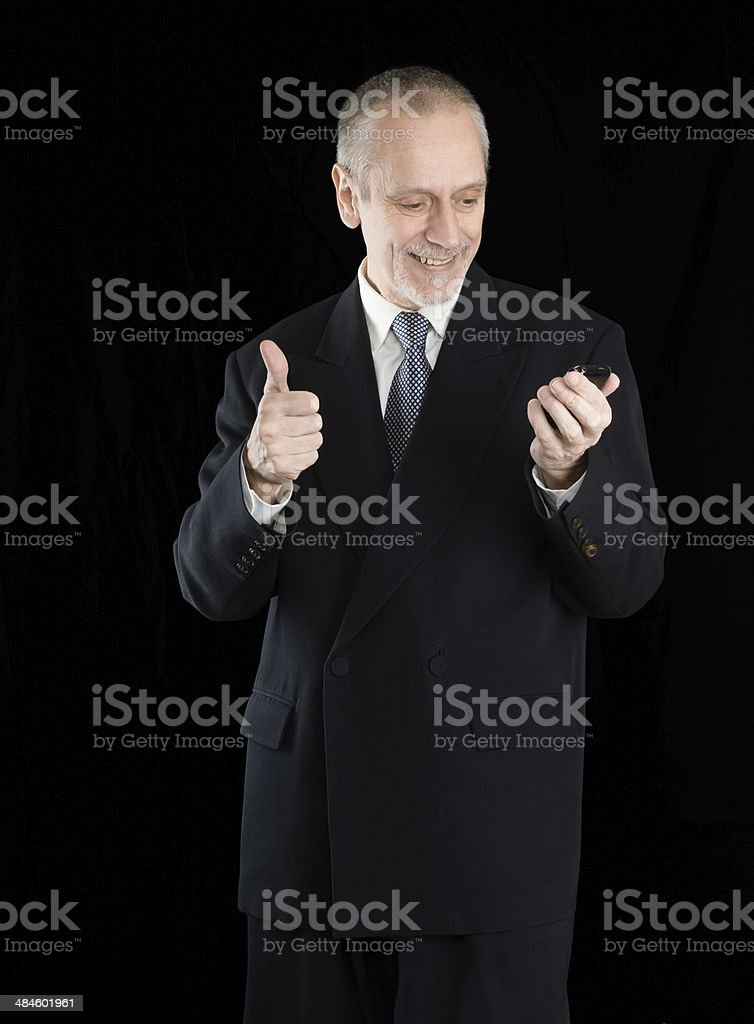 Smiling Thumb Up Businessman on Phone stock photo