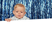 Smiling toddler child with banner
