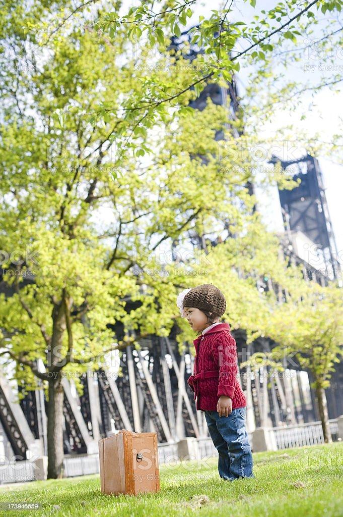Smiling toddler traveler at Portlands Waterfront stock photo