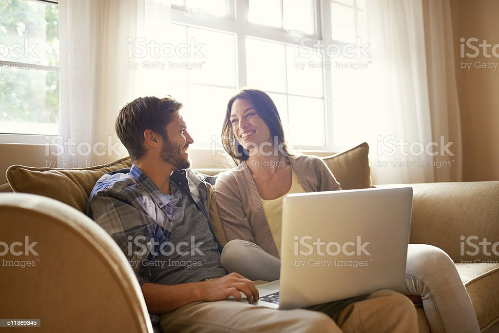 Smiling together over social media stock photo