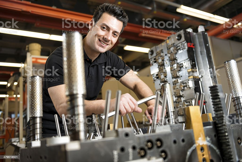 smiling toolmaker looking at camera stock photo