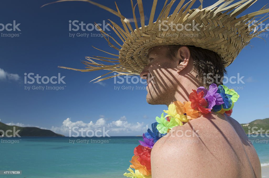 Smiling Tourist with Rainbow Lei and Palm Hat royalty-free stock photo