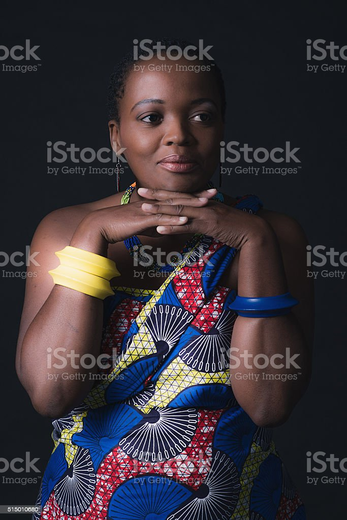 Smiling traditional south african xhosa woman wearing colorful fabric. stock photo