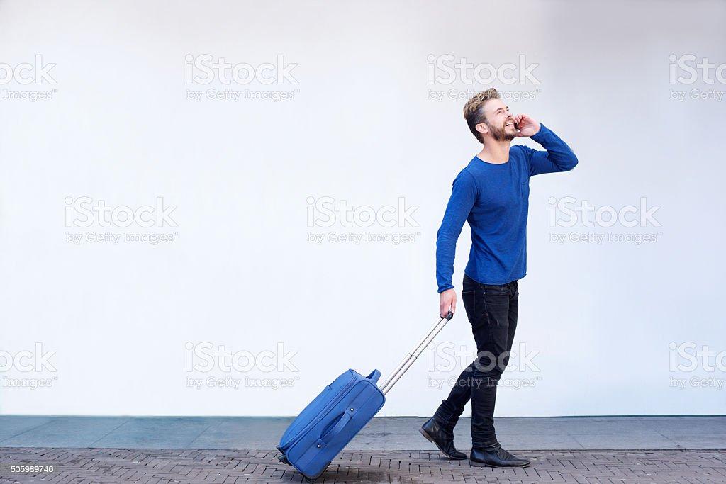 Smiling travel man stock photo