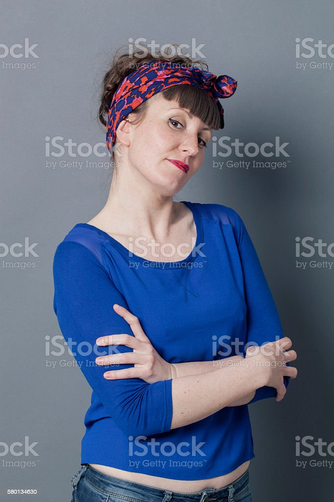smiling trendy woman with chin up and pretentious body language stock photo