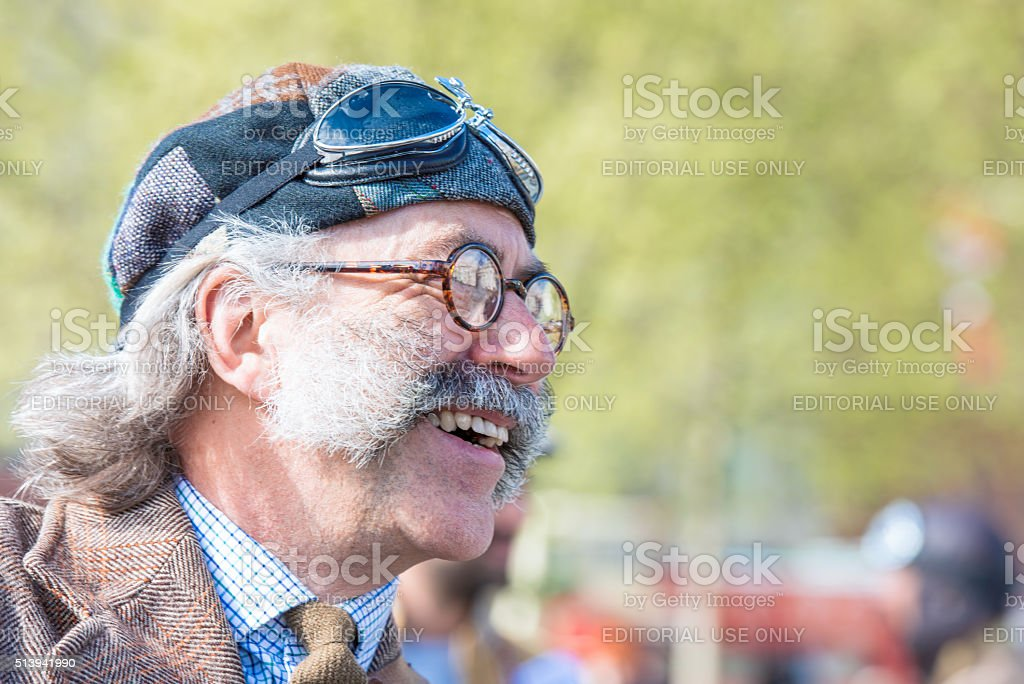 Smiling Tweed Run participant in a great vintage costume stock photo