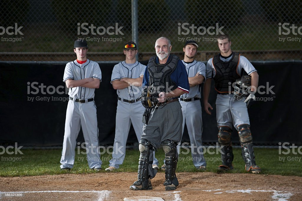 Smiling Umpire In Front Of Baseball Players royalty-free stock photo