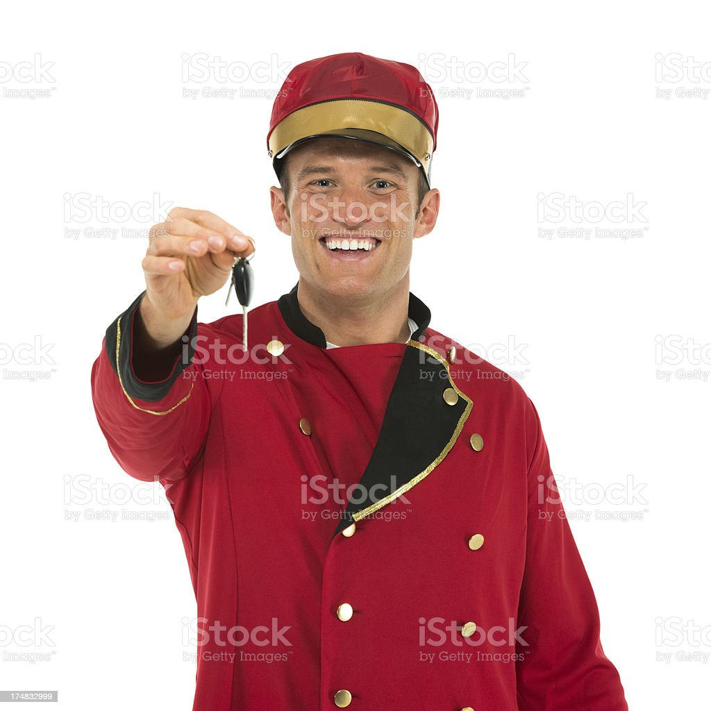 Smiling valet holding a key stock photo