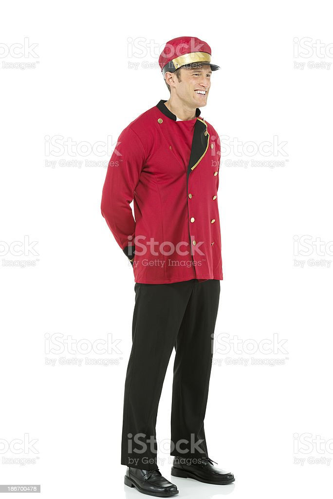 Smiling valet standing against white royalty-free stock photo