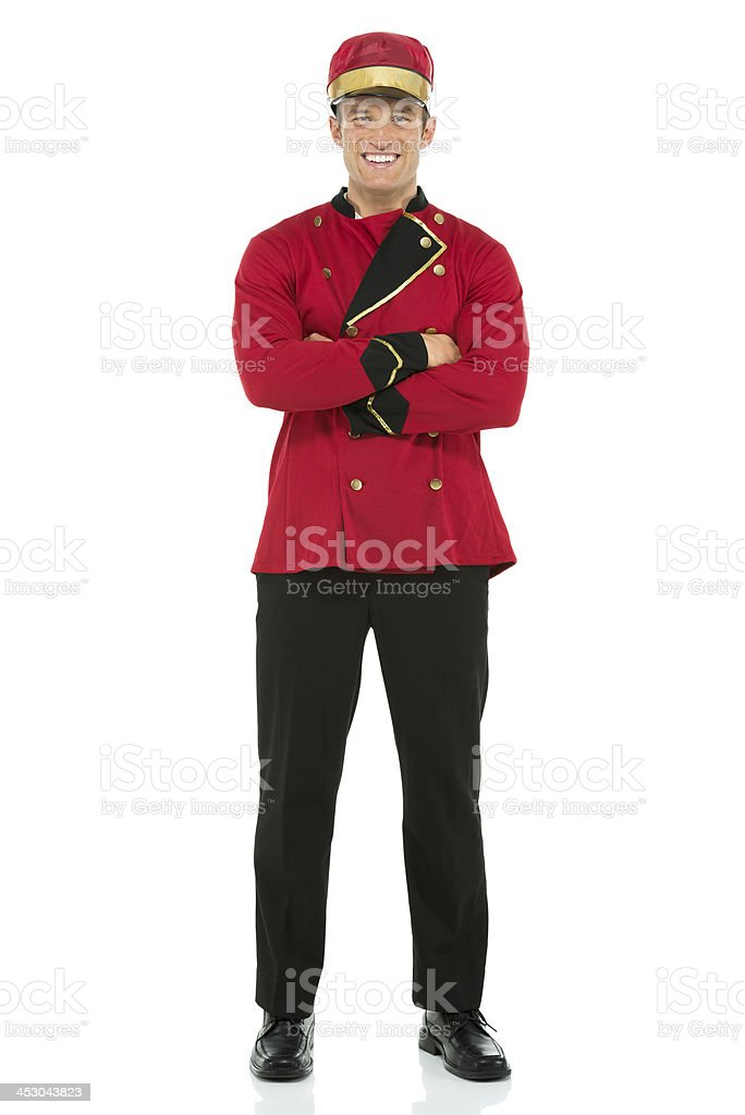 Smiling valet standing stock photo