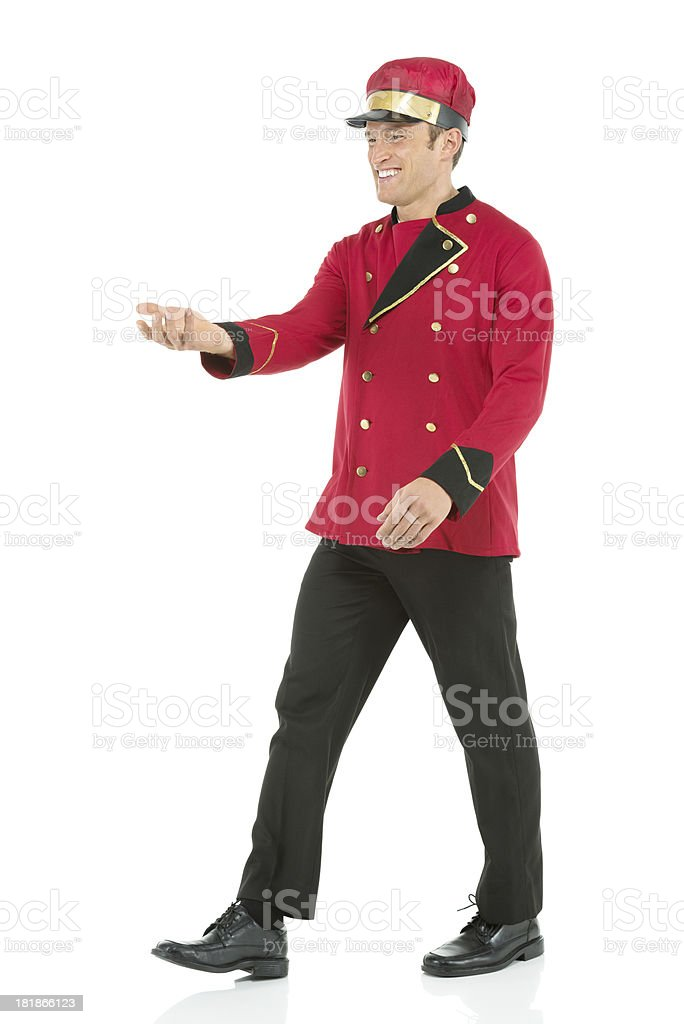 Smiling valet walking royalty-free stock photo