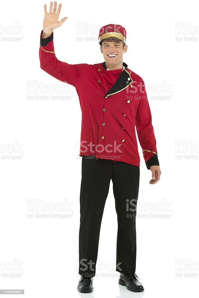 Smiling valet waving his hand royalty-free stock photo