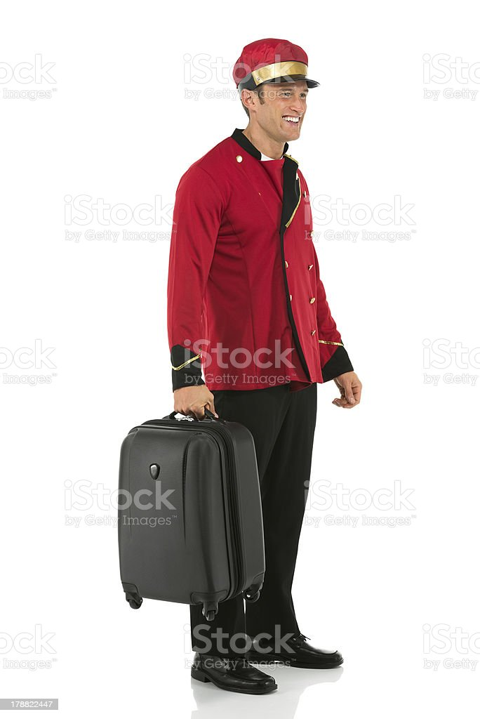 Smiling valet with a suitcase royalty-free stock photo