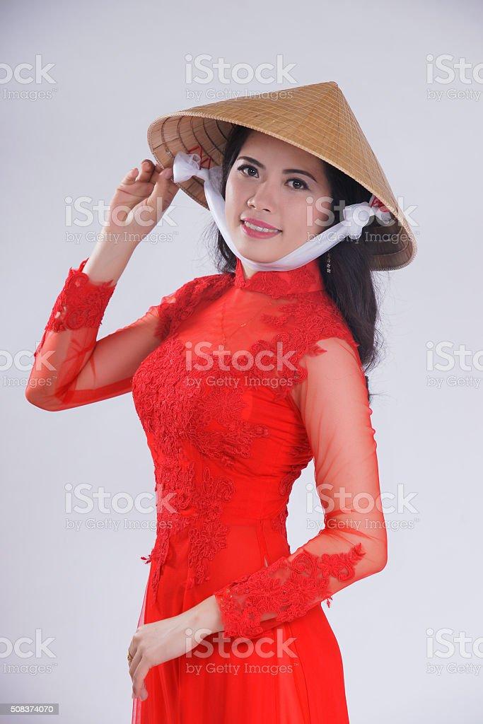 Smiling Vietnamese female with ao dai, vietnam traditional dress stock photo