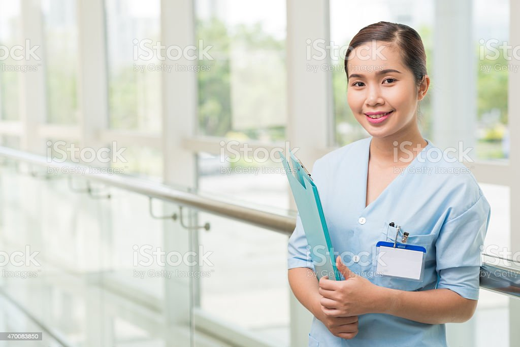 Smiling Vietnamese nurse stock photo