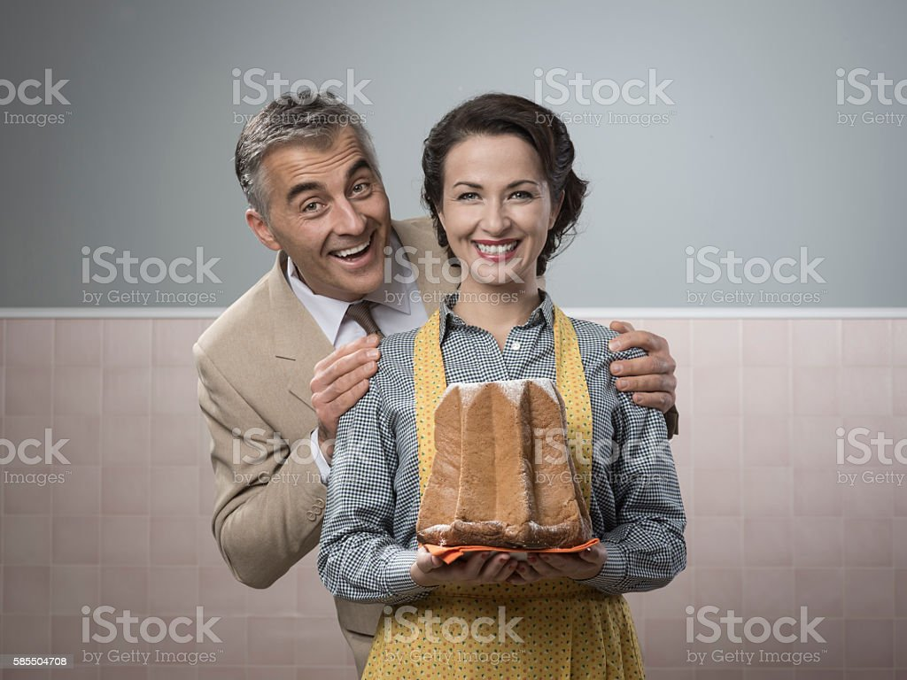 Smiling vintage couple with cake stock photo