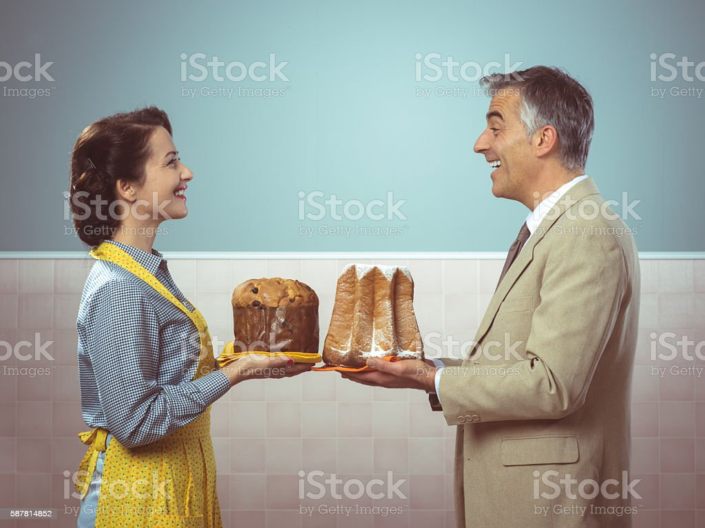 Smiling vintage couple with cakes stock photo