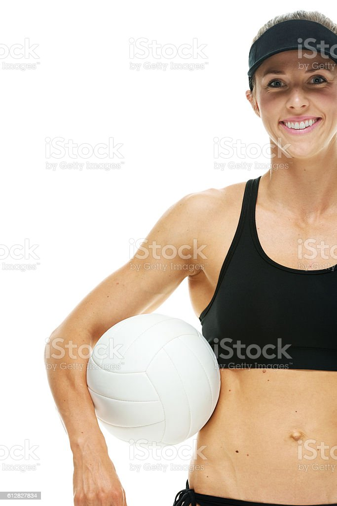 Smiling volleyball player holding ball stock photo