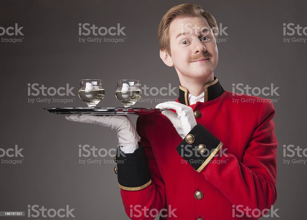 Smiling Waiter in red uniform royalty-free stock photo