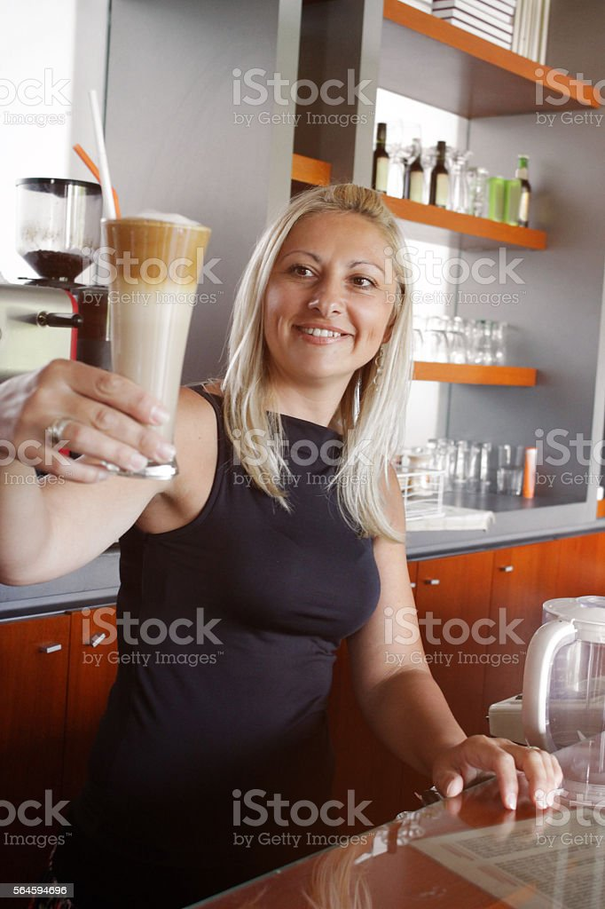 Smiling waitress with her finished coffee stock photo