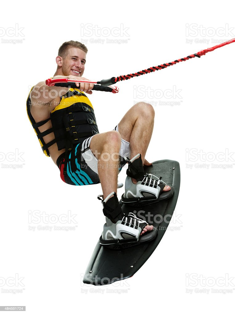 Smiling wakeboarder wakeboarding stock photo