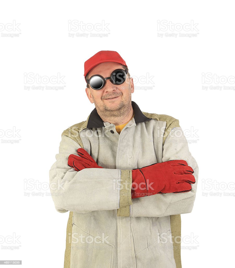 Smiling welder in glasses crosses arms. stock photo