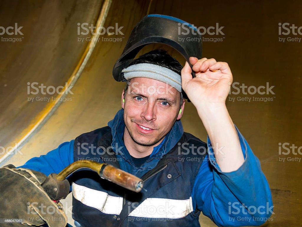 smiling welder stock photo