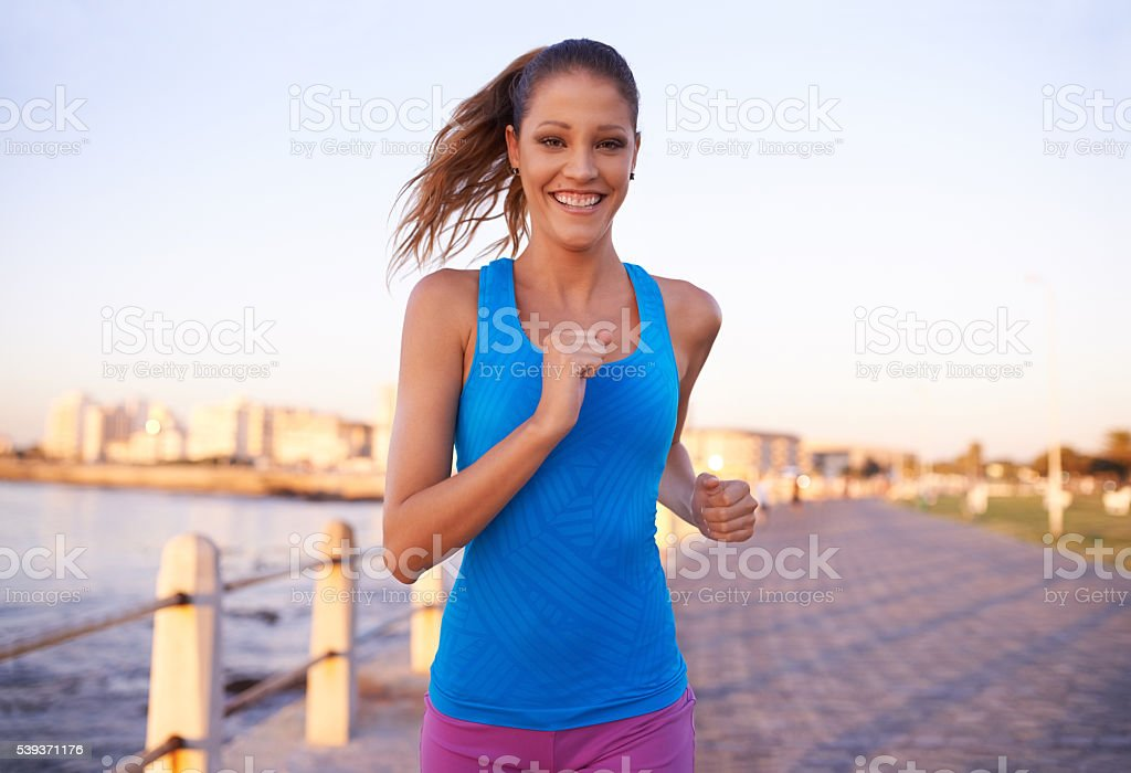 Smiling while working up a sweat stock photo