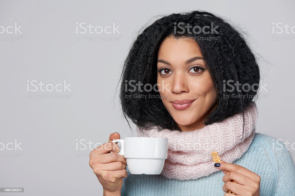 Smiling winter woman with cup of coffee stock photo