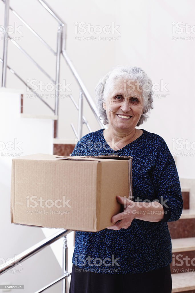 Smiling with box royalty-free stock photo