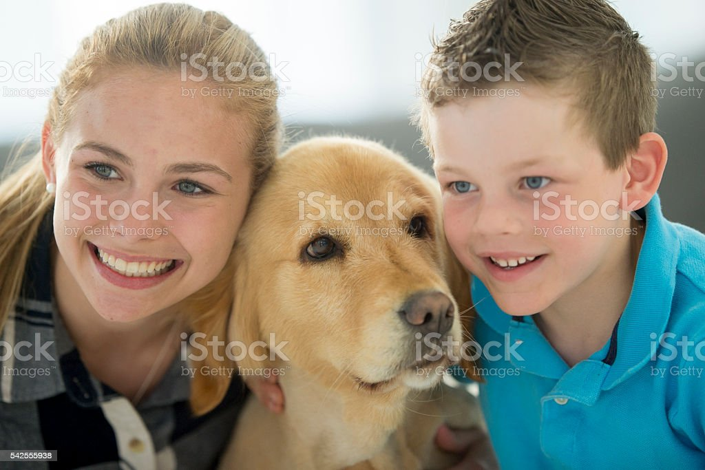 Smiling with the Family Pet stock photo
