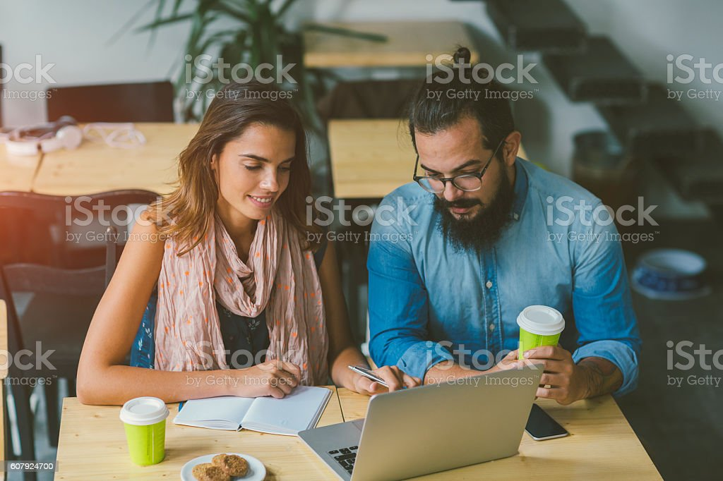 Smiling Woman And Her Colleague In Their Cafe stock photo