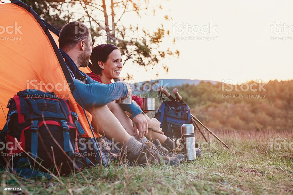 Smiling woman and man resting in the mountain stock photo