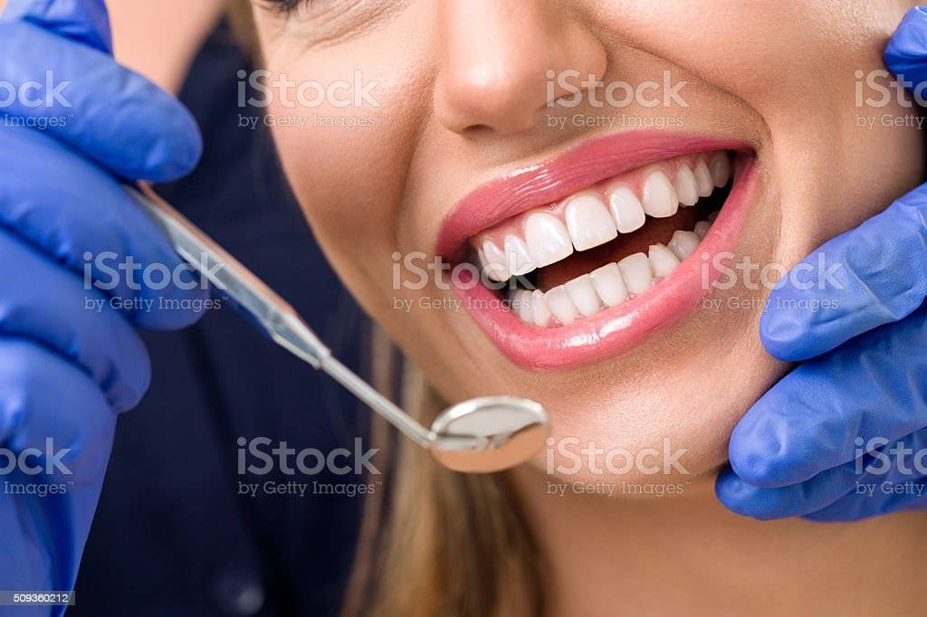 Smiling woman at dentist stock photo