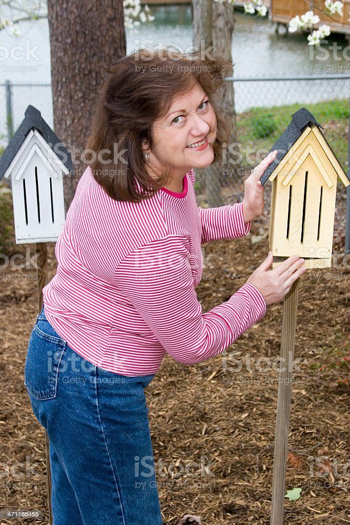 Smiling woman at her butterfly houses royalty-free stock photo